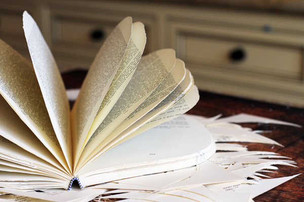 Alright, now it's time to heat up your glue gun. While it's getting hot, fan out your book. Separate the pages as much as possible.