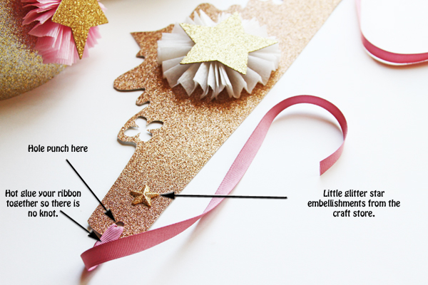 The final step is to hole punch the ends of your crown and string your ribbon through. Make sure not to put your hole punches to close to the ends. Hot glue your ribbon together instead of tying a knot. This makes it more secure and it looks better.