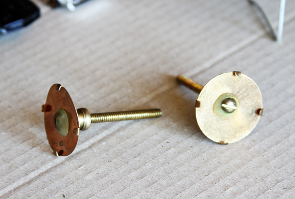 Here is a close up of the knob backers. My metal plate is an inch in diameter.