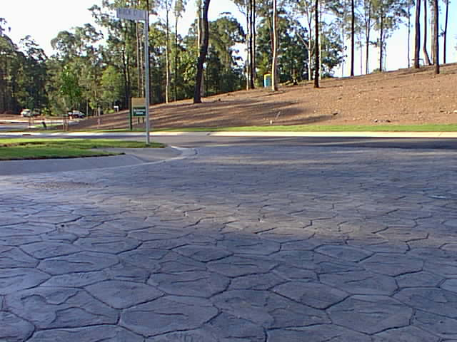 Colour Hardener - An example of stamped concrete using colour hardener. Colour hardener can be used in a vairity of techniques, from throwing on and trowling, to mixing in with base concrete to colour the entire mix.