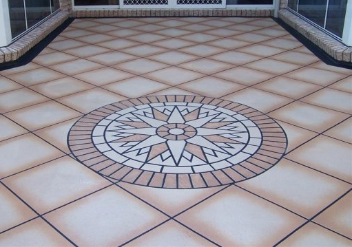 Flocrete - An example of exterior Flocrete application on a backyard patio area, This pattern was completed using a selection of tapes & a single stencil centre piece. A very simple design but leaving a wonderful finished product on the concrete.
