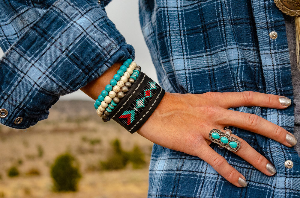 Beautifully beaded cuff by Flyin' A Custom Leather and Beading. Other bracelets & ring by The Rustic Ranch. Vintage Wrangler by The Desert Wind Boutique.