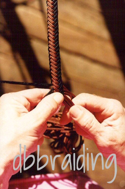 My hands braiding a Mecate