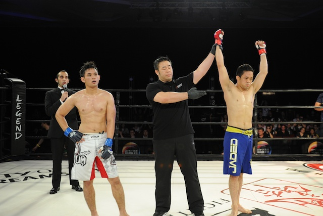 Diego winner arm raised at Legend 9 MMA