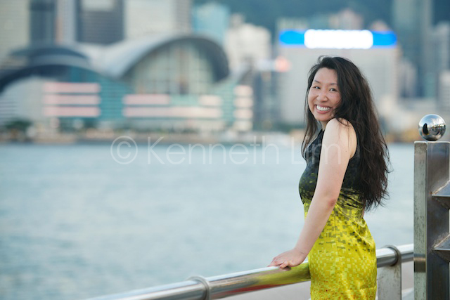 Hong Kong headshot portrait outdoor Victoria Harbour asian female looking back smiling
