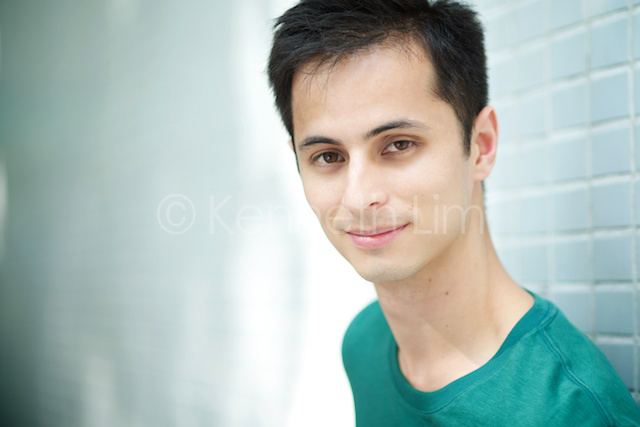 Hong Kong headshot portrait outdoors male smiling against wall