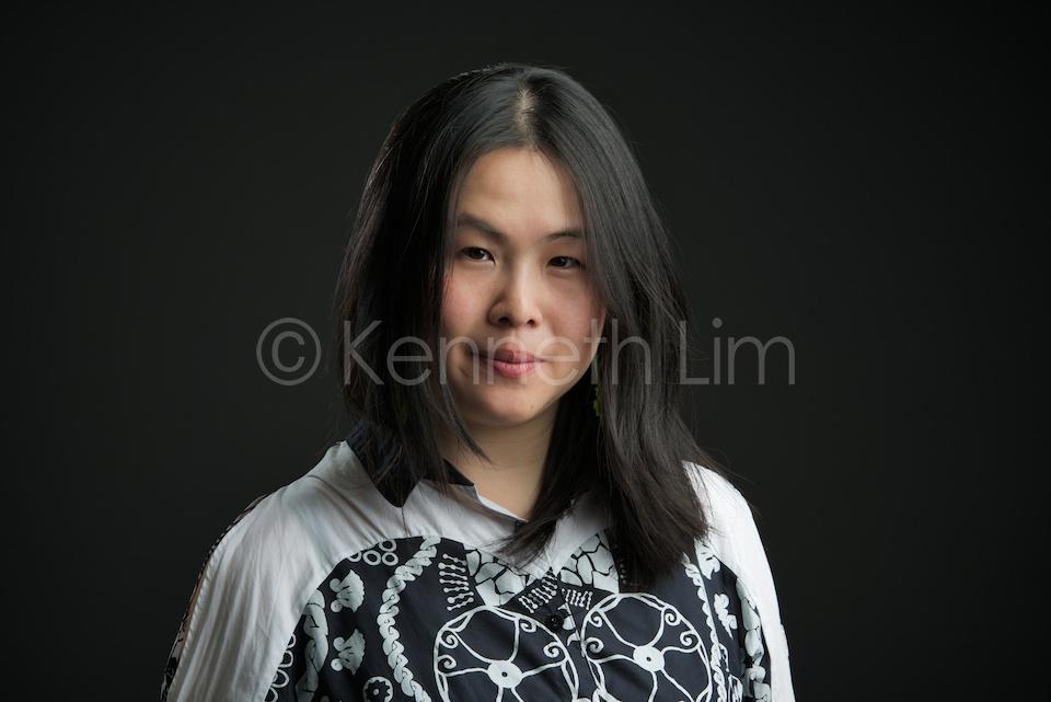 corporate headshot hong kong chinese woman long hair black background