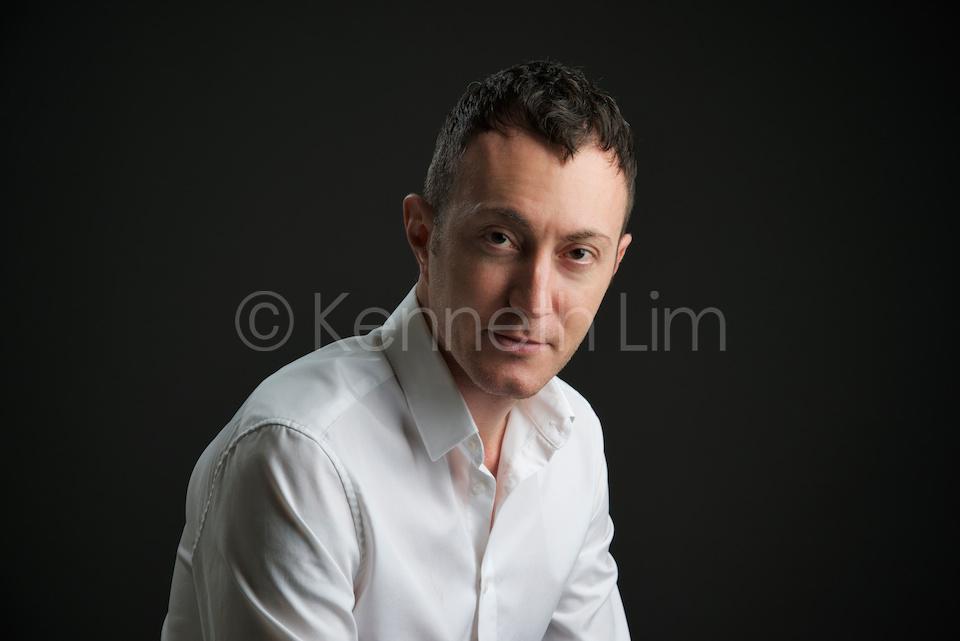 corporate headshot hong kong italian man black background