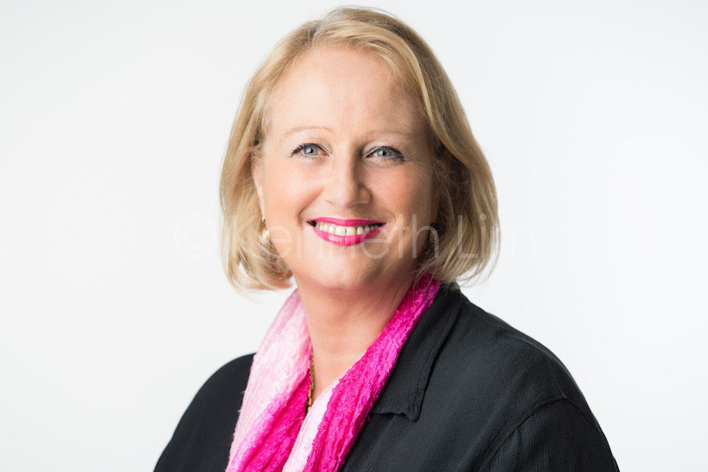 corporate headshot hong kong executive female light background professional