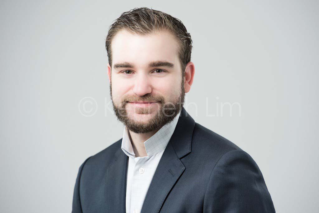 corporate headshot hong kong executive light background male smiling friendly