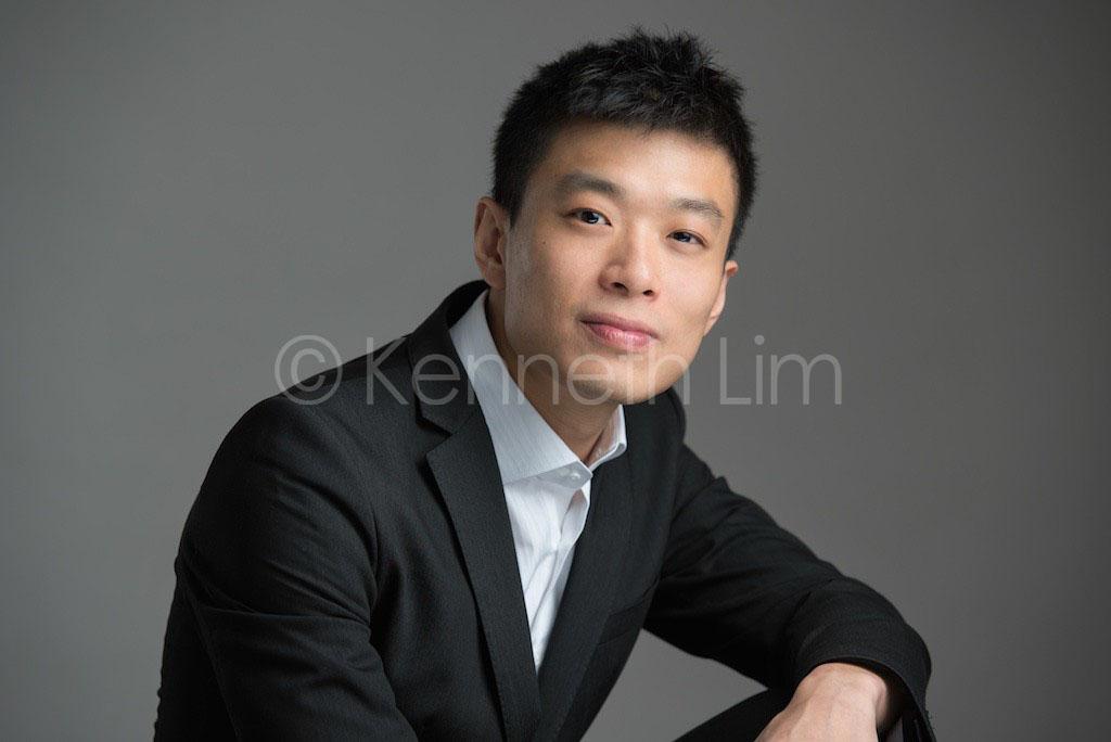 corporate headshot hong kong executive professional banker portrait in studio dark background