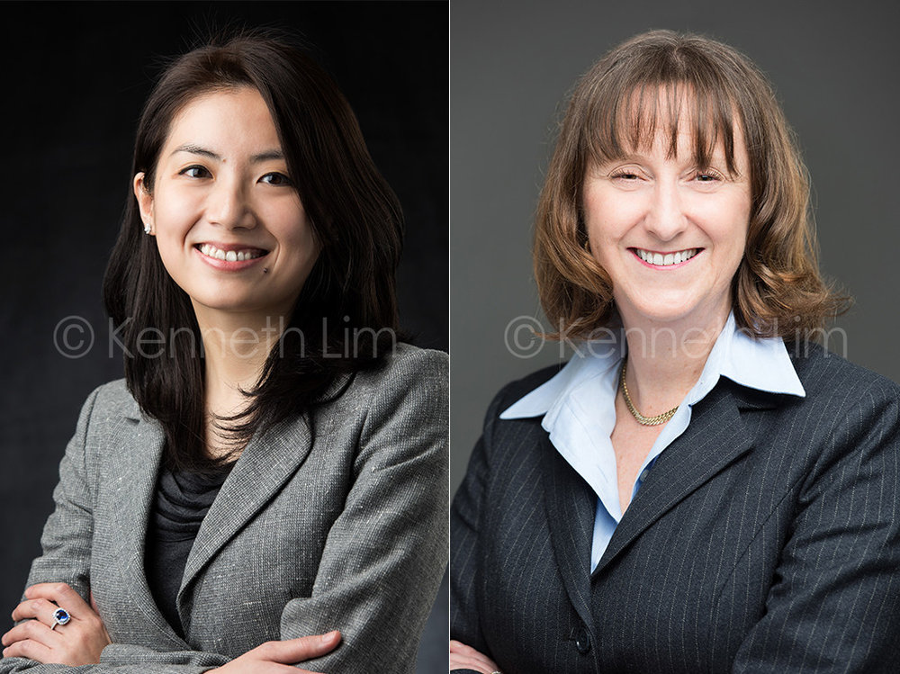 corporate headshot hong kong two female executives smiling dark background