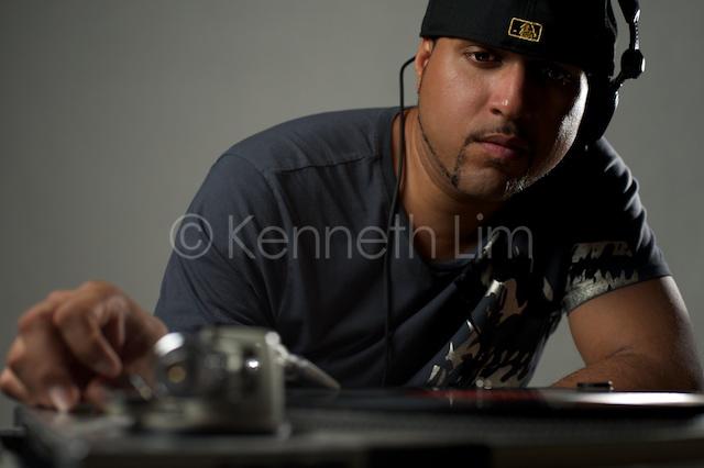 DJ Gruv looking over turntables