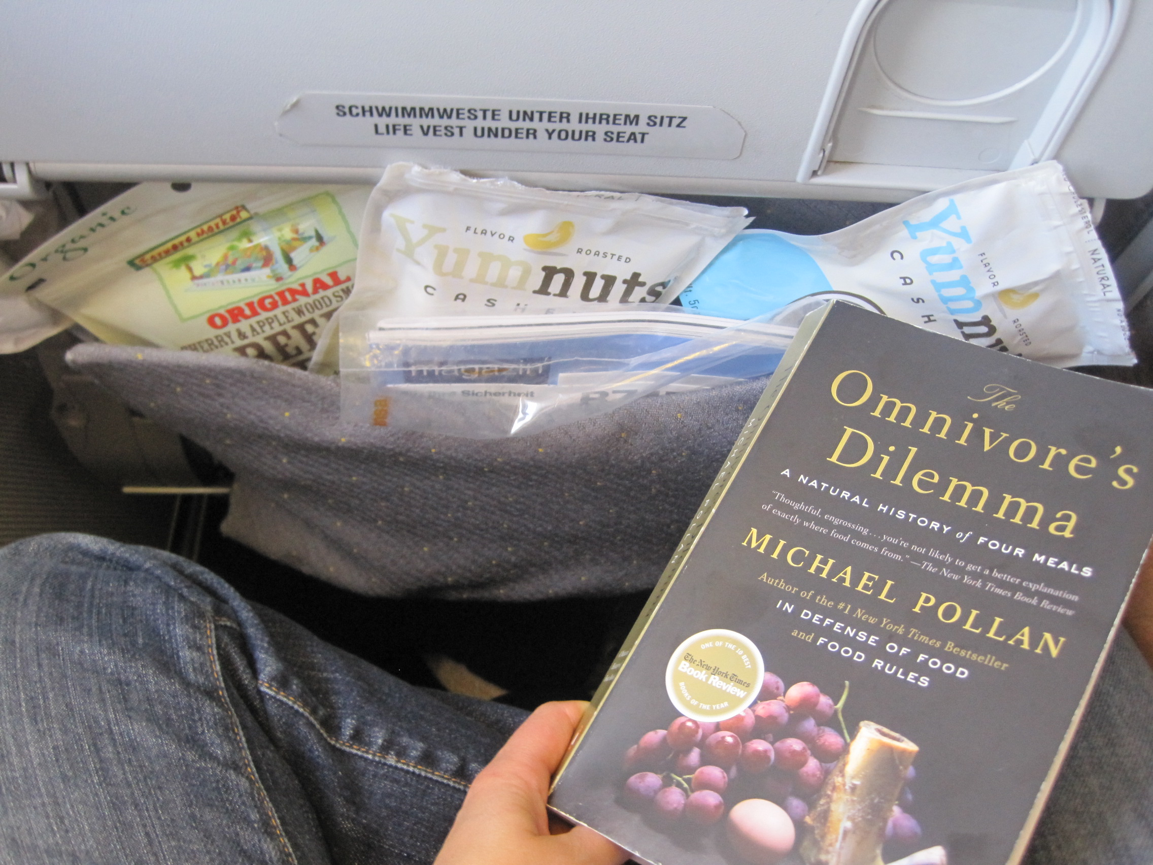 "On a flight to Istanbul in July 2011, still packin! I see some beef jerky and plenty of ""YumNuts"" from Whole Foods! Don't forget to bring a good read!"