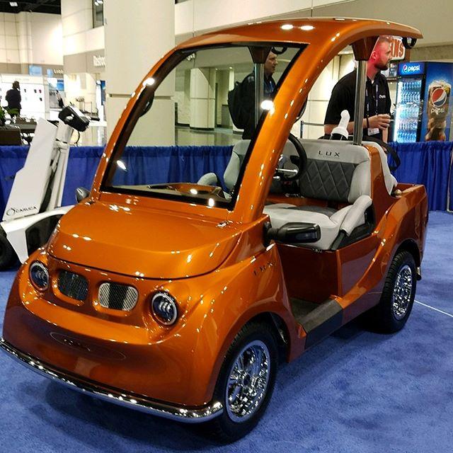 She looks sharp in orange, doesn't she?? #pgashow #pga #golfcart #golf @pgagolfshows