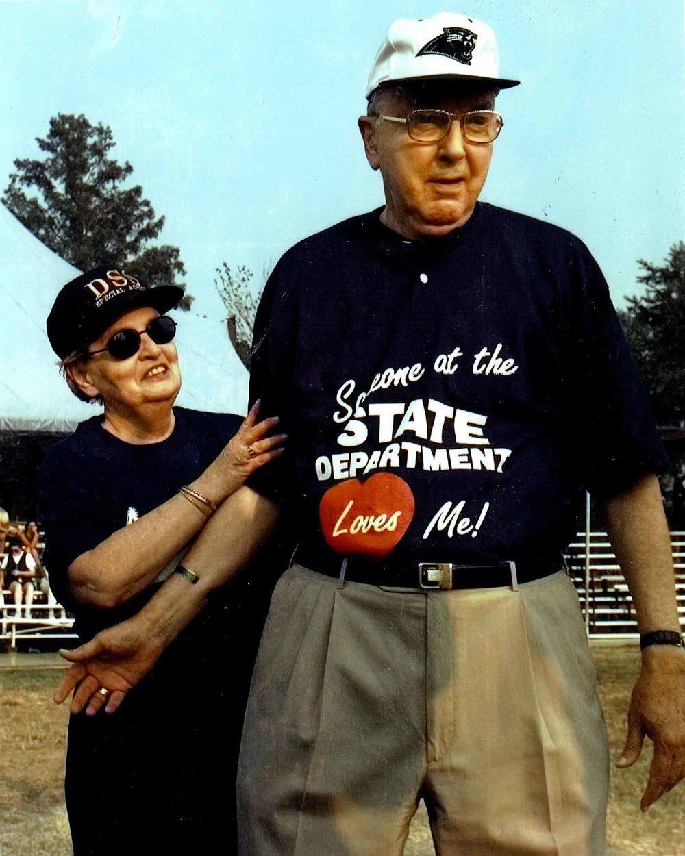 Secretary Albright and Senator Helms wearing the T-Shirt she gave him when she spoke at Wingate University.