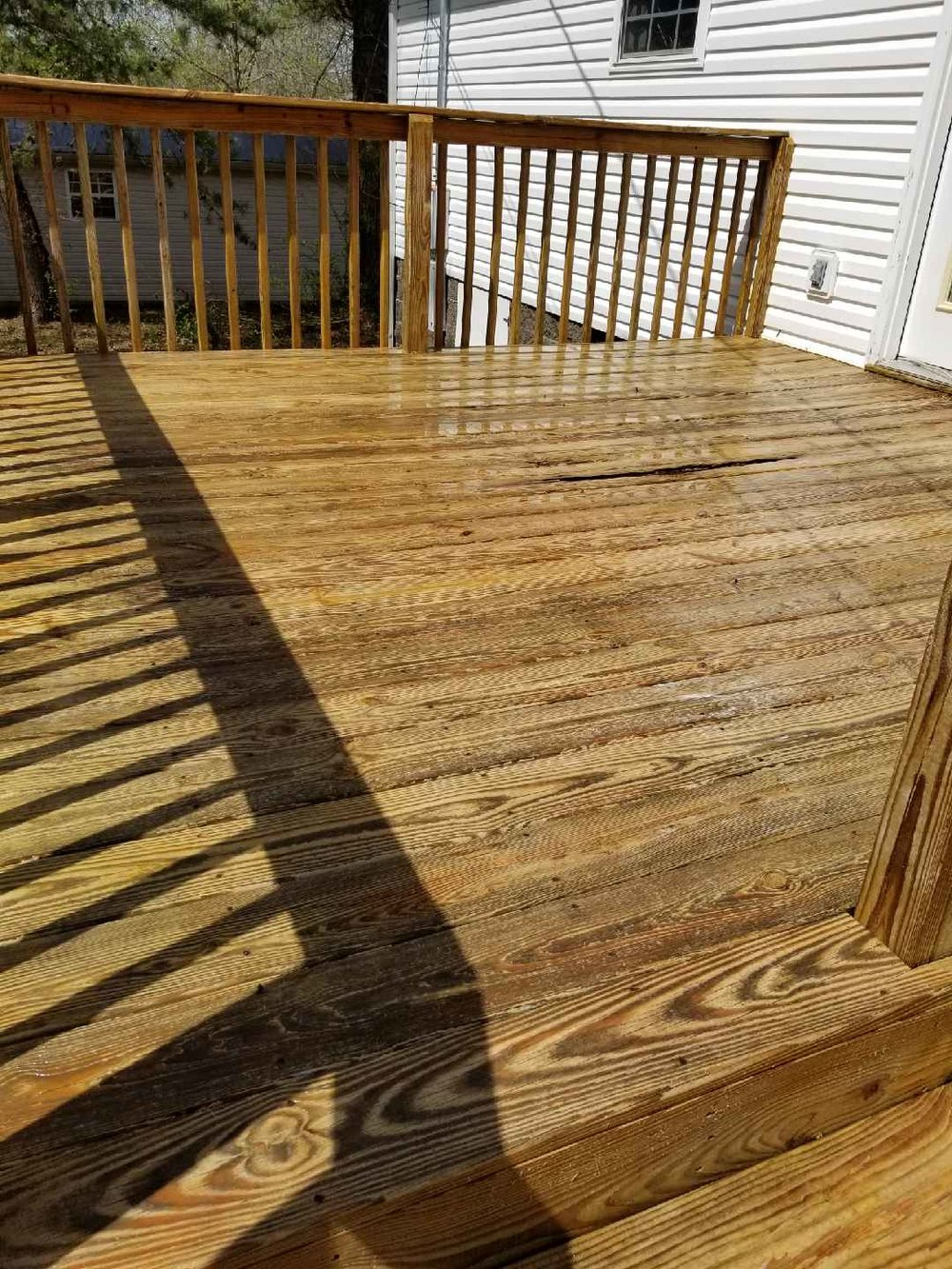 After our deck pressure washing services it looks brand new!