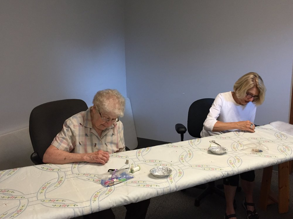 Joan Eickhoff & Carol Nelson working on a homemade Festival quilt