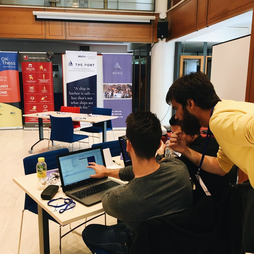 Computer Science Mentor Sotiris helping team with their code