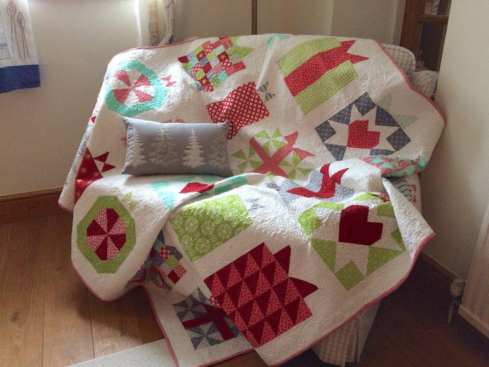 Christmas Quilt on the sofa.JPG
