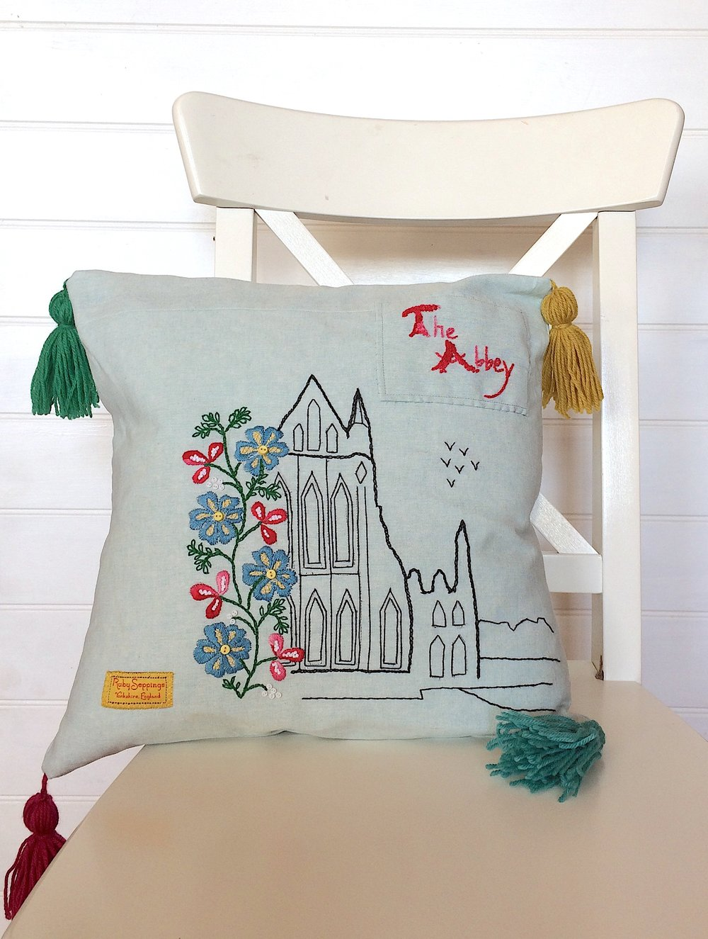 The Abbey embroidered cushion