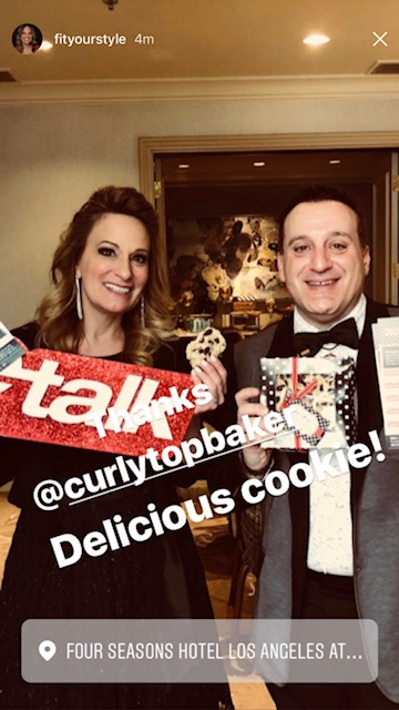Jennifer Ettinger & Tommy Geraci from etalk enjoying cookies at the Four Seasons Hotel