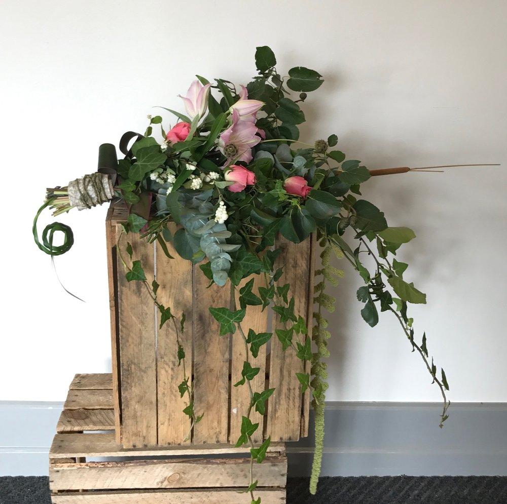 Protea, Eucalyptus over arm bridal bouquet