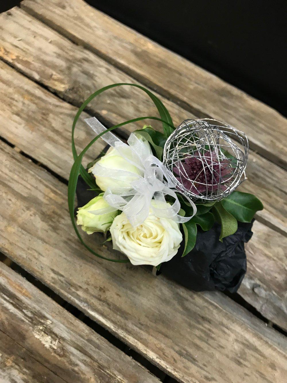 Modern wristlet roses grass wirework corsage