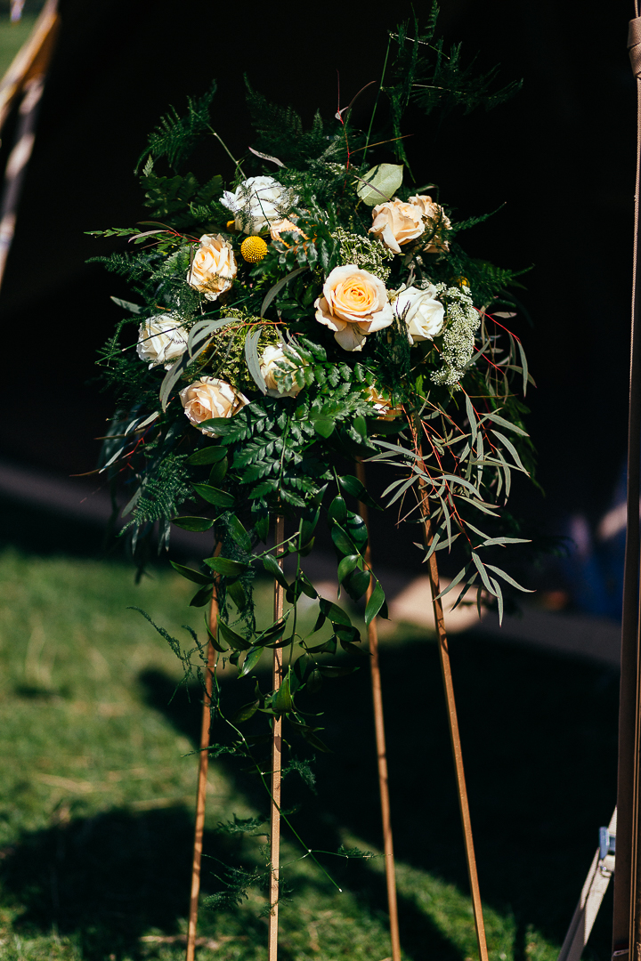 Geometric Stand with Roses & abundant foliage - perfect for a summer wedding - can be used as table centre pieces or floorstanding arrangements to define an aisle or entranceway Photography by Silverbird.