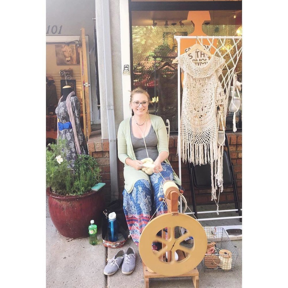 Lucy spins yarn, much to the delight of passersby outside of Rainbow's End in downtown Flagstaff, AZ.