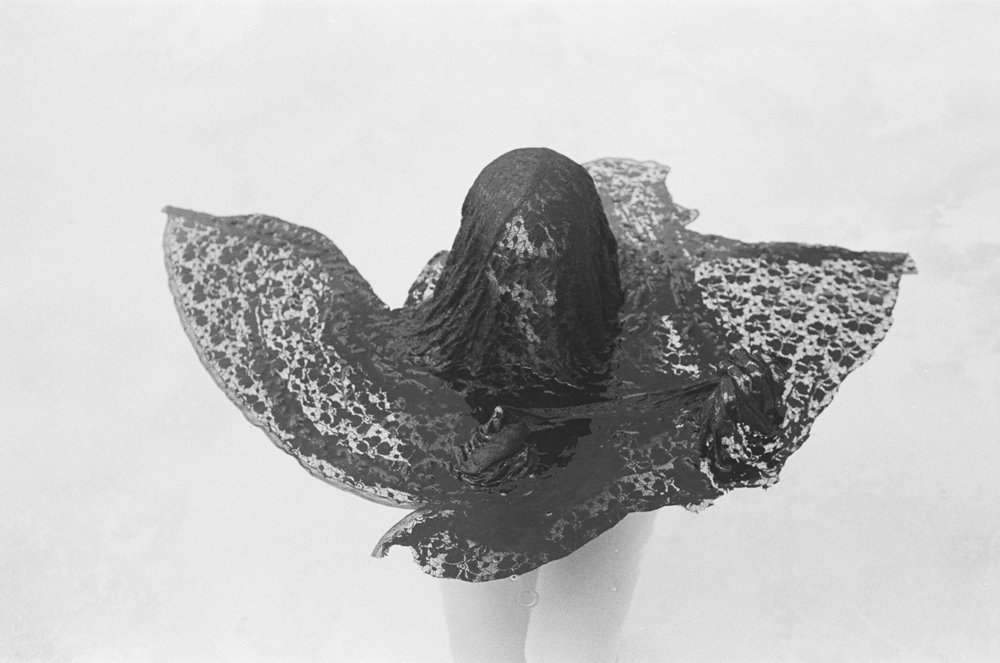 """Breaking Free"" demonstrates young women coming out of their shells.  They are freeing themselves from being trapped and becoming a better, more confident self.  The fabric placed in all the photographs metaphorically stands as the women's shells.  Each fabric resembles a different stage of freeing oneself. 