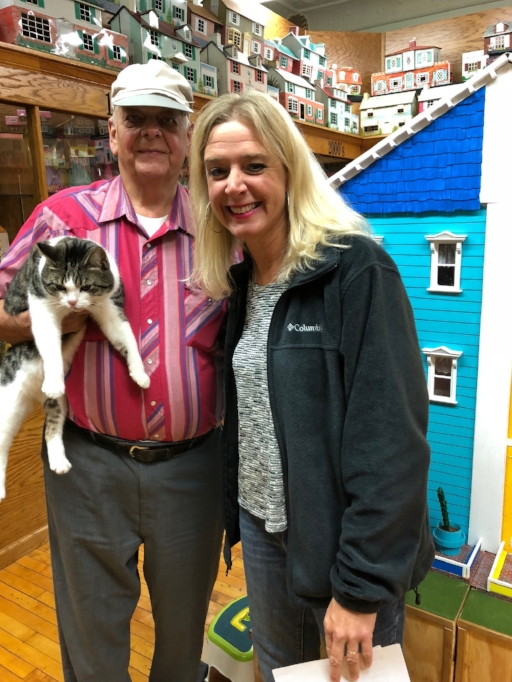 Lou , the cat, my dad and I standing in front of the largest handmade interactive dollhouse to date. The builder was my dad :0)