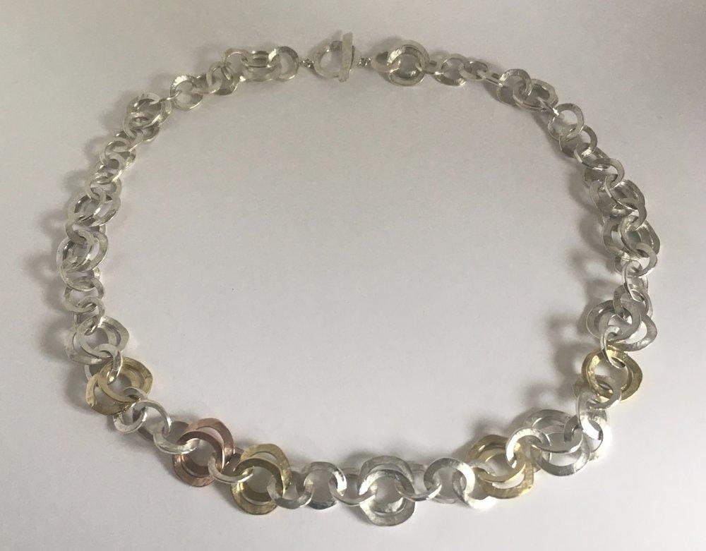 interlocking links,multi colored gold, silver