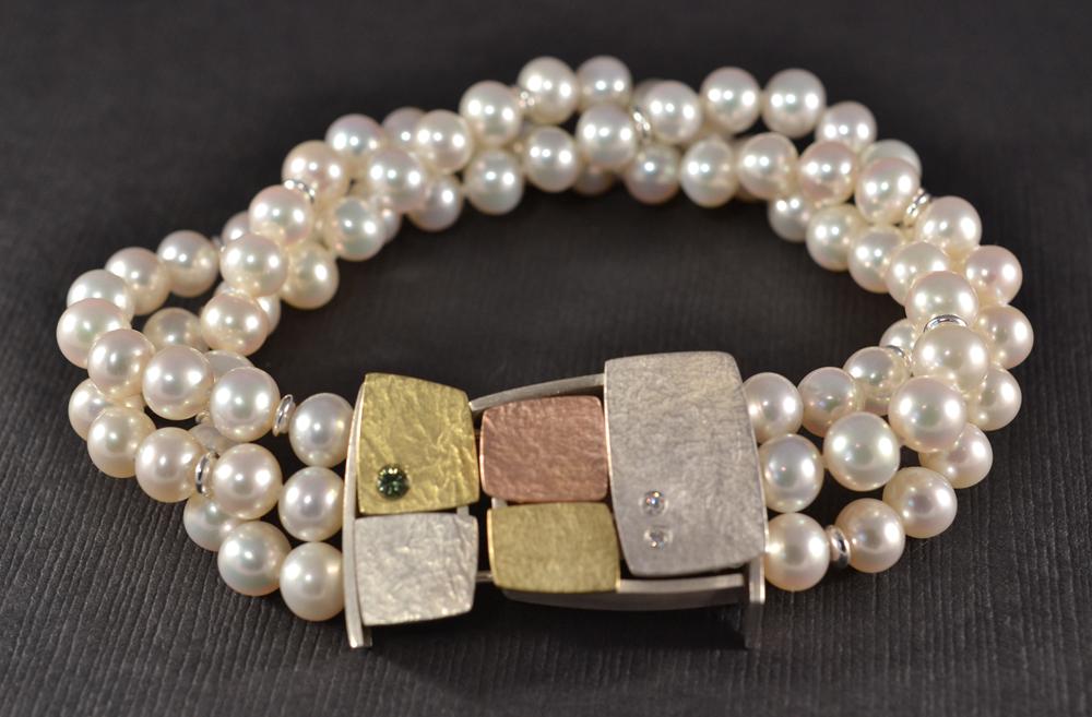 multi colored gold, silver, pearl, tourmaline, diamond