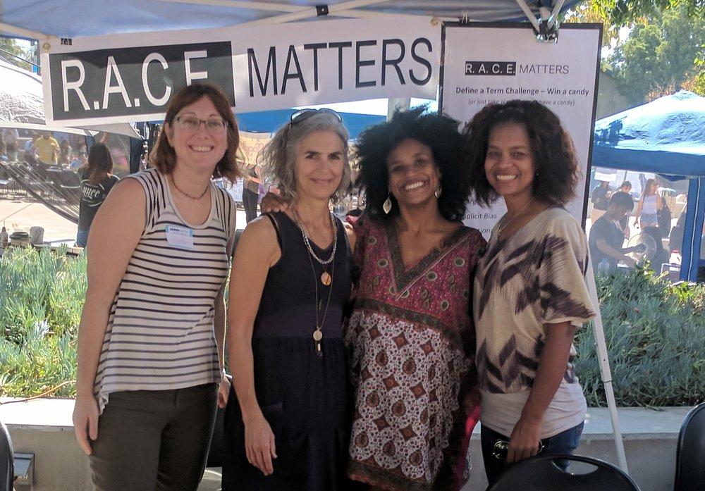Julie Fallon, Stephanie Allen, Courtney Haile, and Julie Lynem woman a booth at Cal Poly's Culture Fest.