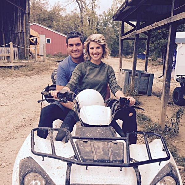 Ivanoff and wife sitting on four wheeler, the head of Columbus landscaping company.
