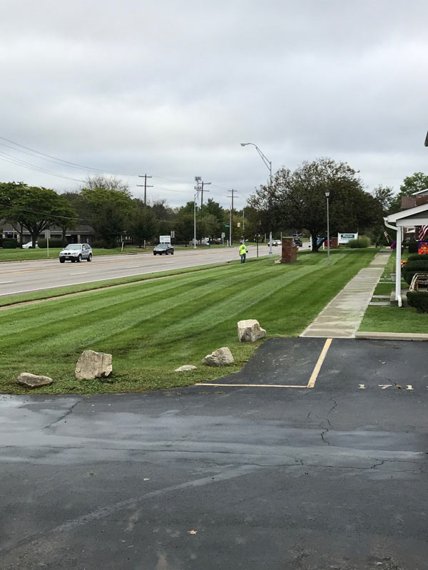 Fresh mowed grass by parking lot, Columbus landscaping company Ivanoff to thank!