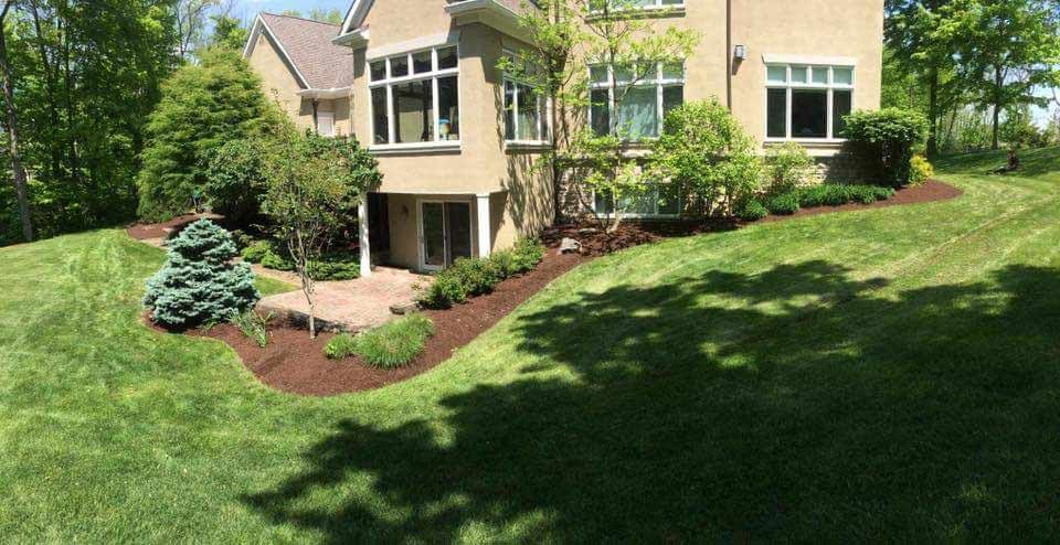 Beautiful Landscaped Back Yard Of Home, Lawn Care By Landscape Company.