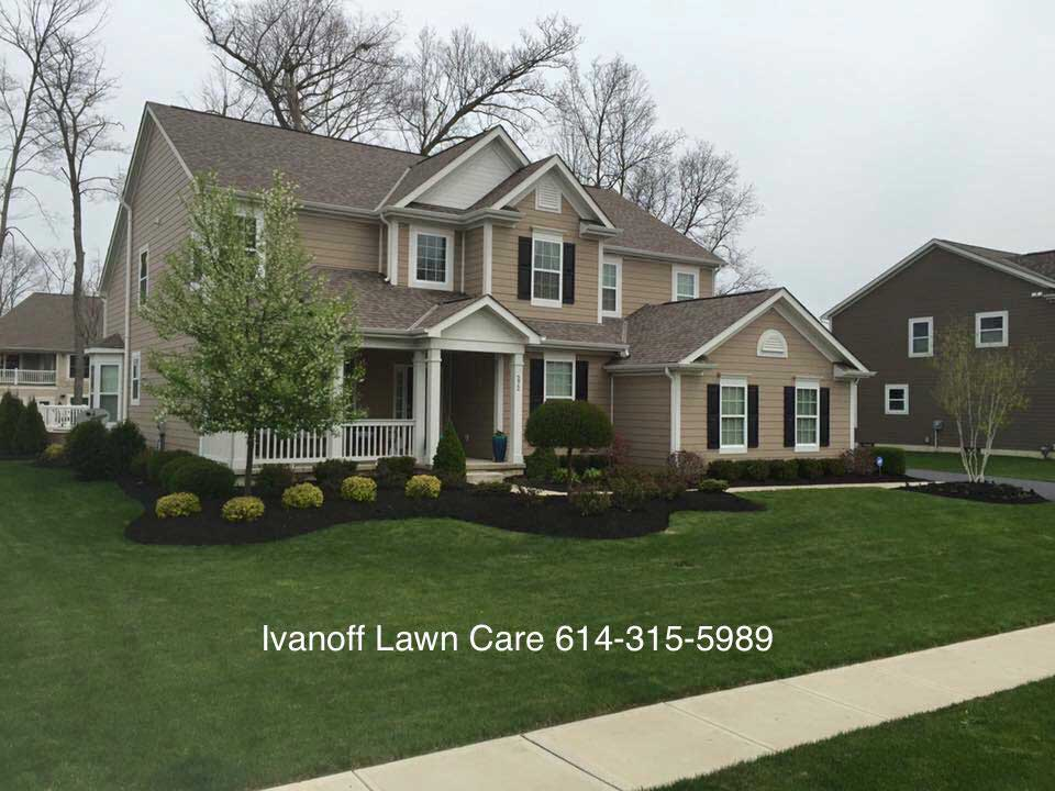 Well kept front lawn of home by Columbus landscape company.