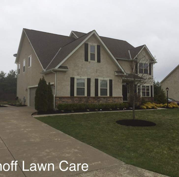Home with freshly mowed front lawn, Landscaping services by Ivanoff.