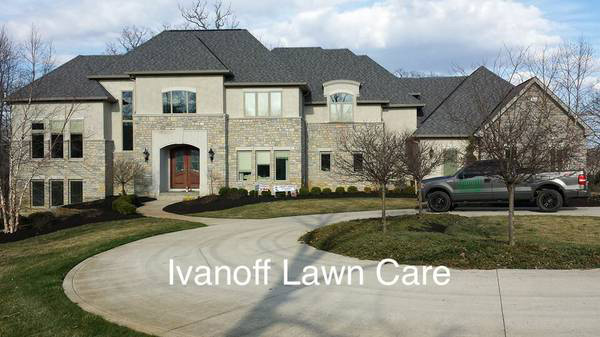 Mansion's driveway and front yard, lawn care and landscaping services by Ivanoff.