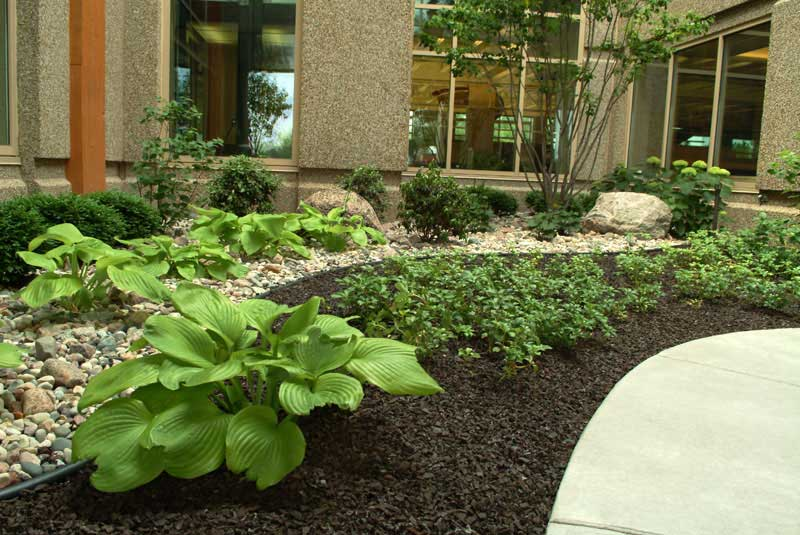 Commercial entry way landscaped plant bed by Delaware landscape company.