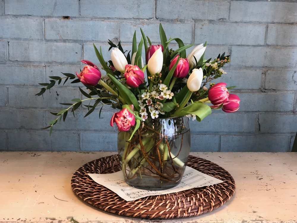 Chase the winter blues away by joining  Merci Beaucoup Floral  on Saturday, January 26, 2019 at 10:00 am for a floral arranging workshop featuring colorful TULIPS!  Together we will create a beautiful arrangement guaranteed to brighten your home this winter.  Grab your friends and come for a fun morning of learning and creativity!  Cost is $45.00  Cost includes: Vase, flowers and all supplies.  Light refreshments will also be served.  Follow link for more information or to register!   Eventbrite Link