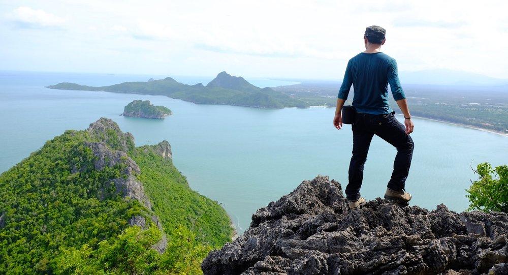 AdobeStock_Climber overlooking ocean.jpeg