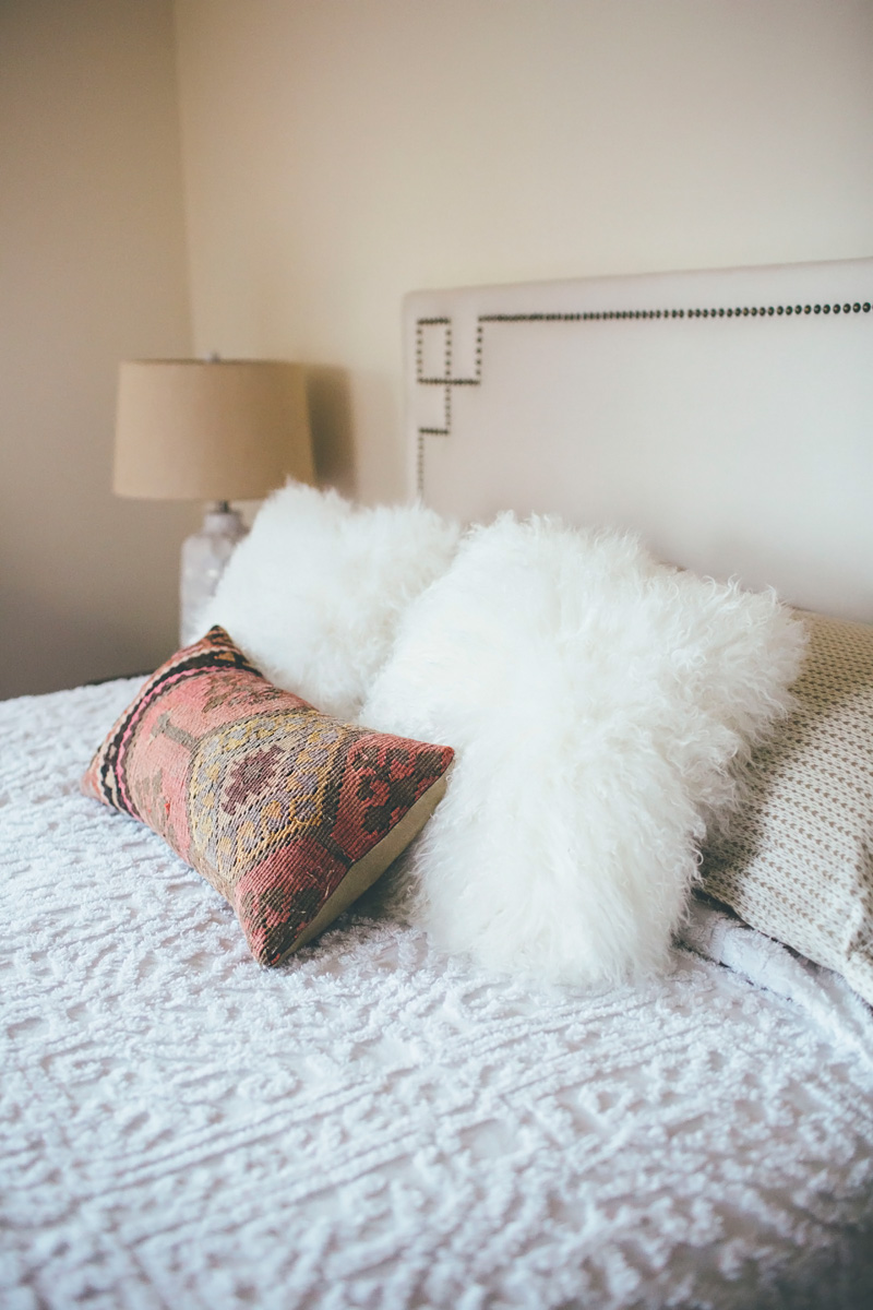 Notice how Alice Wingerden of  Thoughts from Alice  adds fur pillows to transition a bed into fall.