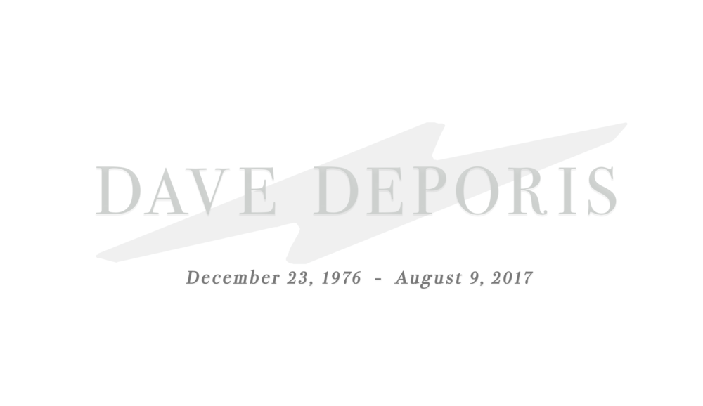 Front page logo, Dave Deporis in large lettering with December 23rd, 1976 to August 9th, 2017 written smaller below -- Overlayed on a large gray and dark green photo taken by Dave of dense fog engulfing the treeline at Muir Woods National Monument, a redwood forest he loved and visited frequently while living in Oakland, California.