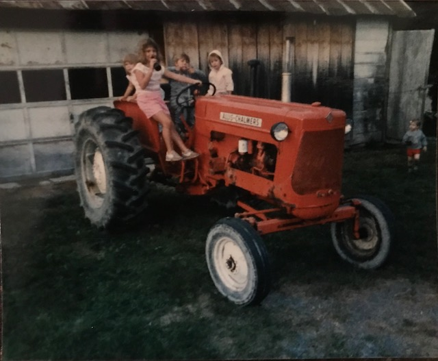 Copy of Children sitting on a farm tractor.