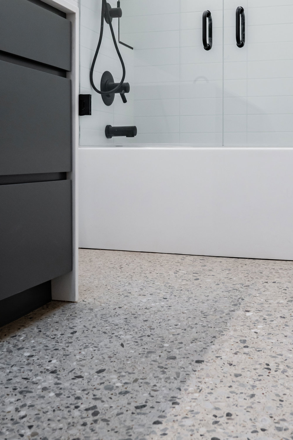"Low gloss ""Class 1"", Large Aggregate Exposed ''Class D"" Craftsman Concrete Floor. The aggregate has been chosen for its jagged shape and gray color. Notice how tightly the rock is incorporated into the floor, creating a terrazzo style finish."