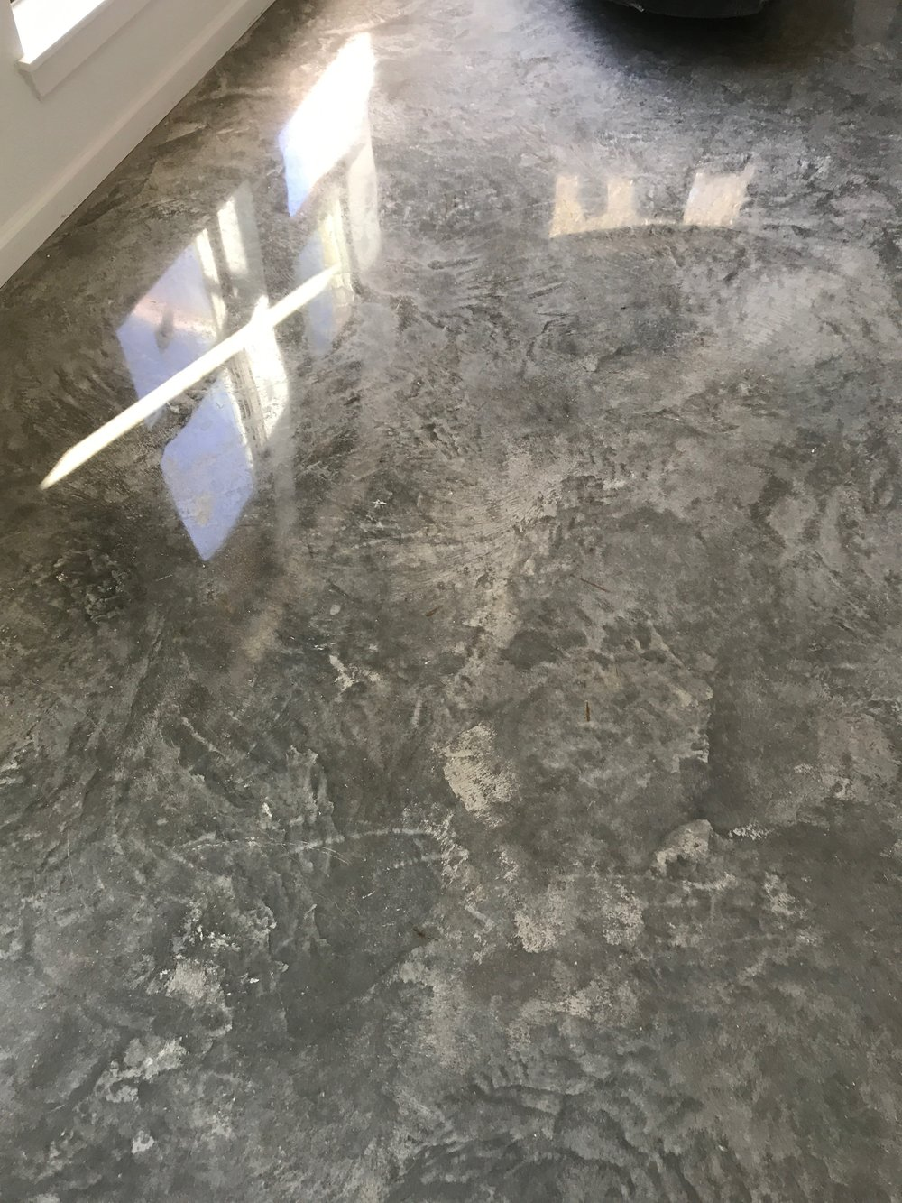 A 10% fly ash, cream polished Craftsman Concrete floor. The high fly ash content increases the depth of the natural design on the floor's surface and allows for a highly reflective finish.