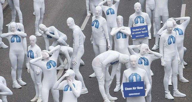 Greenpeace activists protesting in Stuttgart, Germany one week before the landmark ruling. Photo courtesy of AFP.